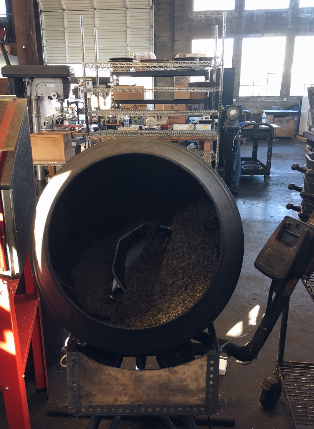 Pan seasoning in process, in a cauldron with birdseed and flaxseed oil.