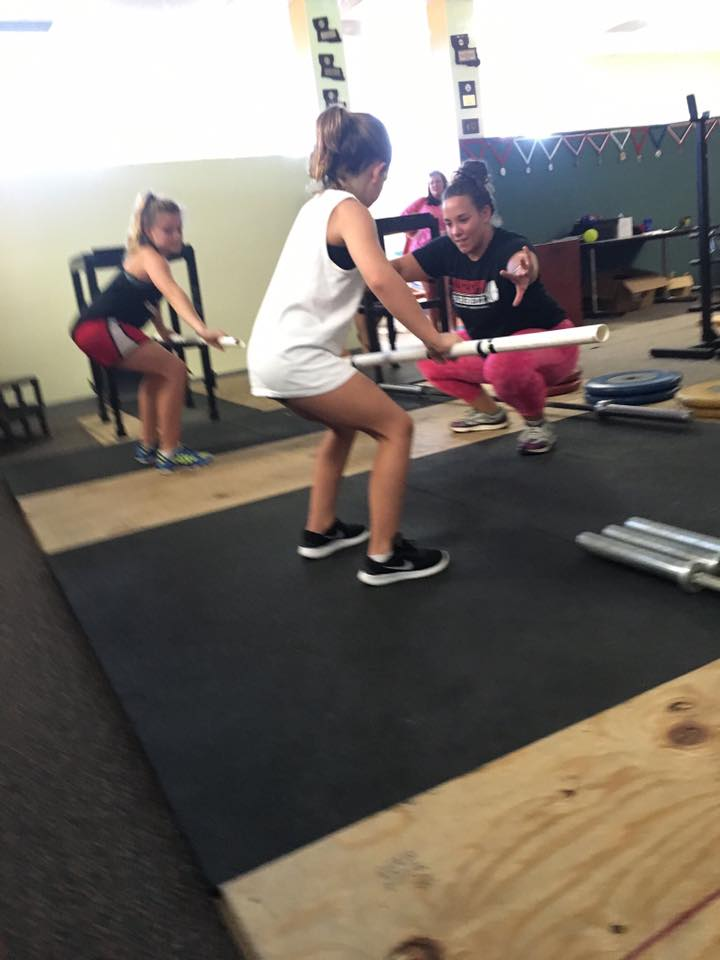 Working with two female youth weightlifters (aged 7 and 9) at Mississippi Barbell