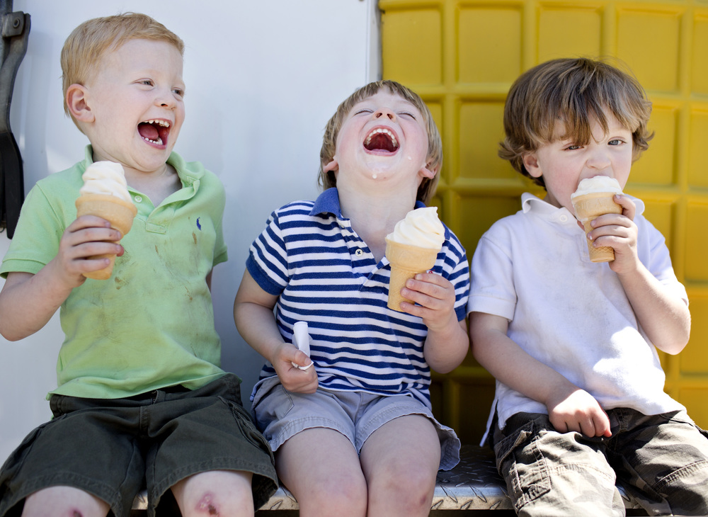 Carver Rudolph, 4, left, Webb Lathan, 3, center, and Gray Wheeler, 3, enjoy soft-serve ice cream cones during the 'Cuegrass Festival in downtown Raleigh, N.C. on Saturday, April 26, 2014.