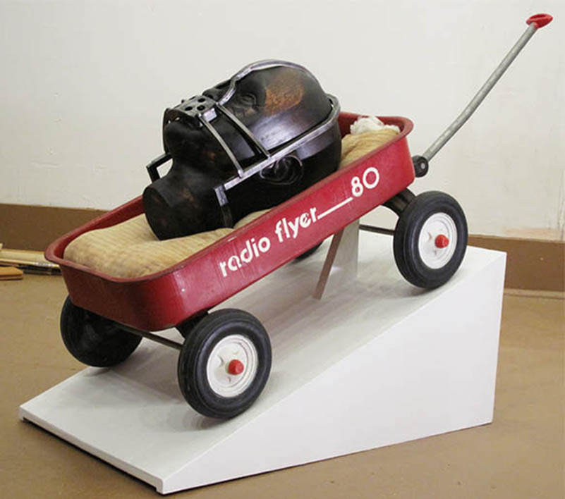 mao_14.jpeg_the weight of memory 2012. carved wood forged steel pillow rust radio flyer stain wax. 12x40x14 inches..jpg