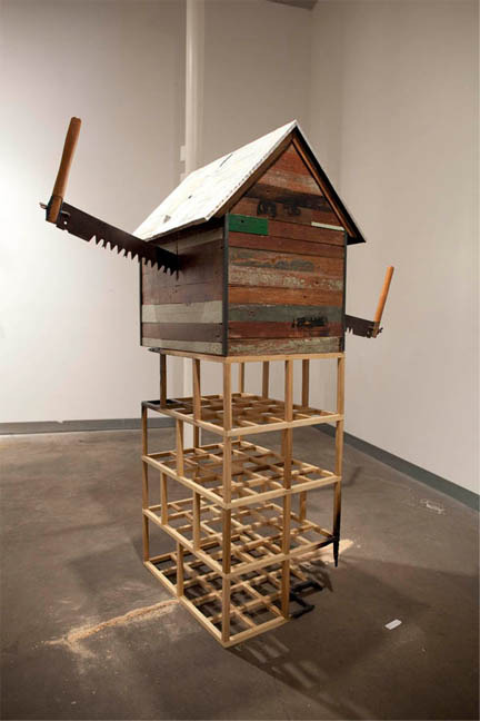 mao_4.jpeg_to gut 2011. wood steel tin saw sawdust silkscreen on wood paint. 65x22x35x48 inches..jpg