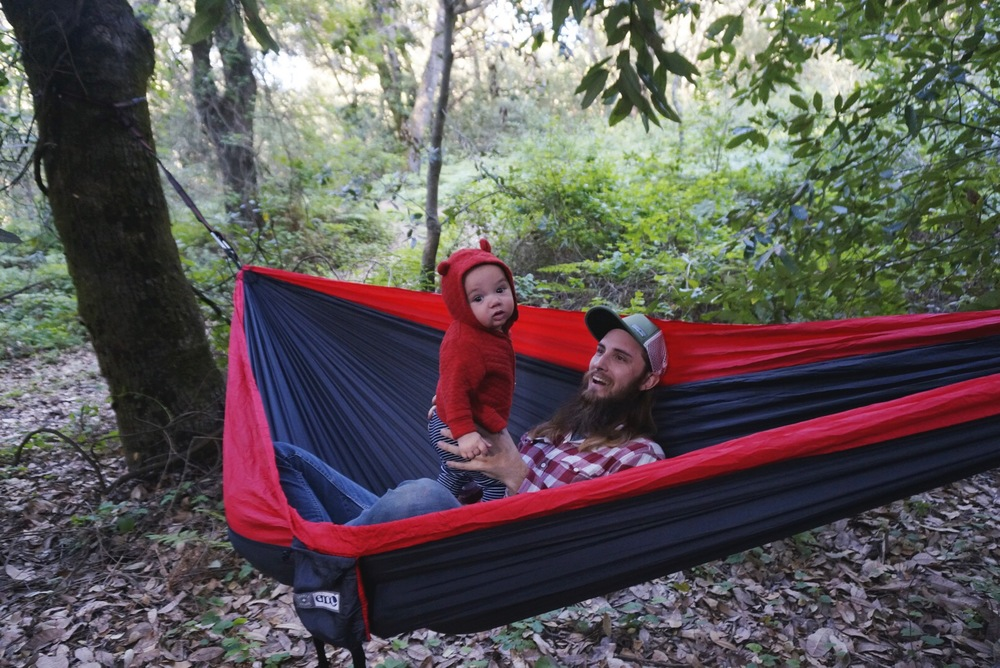 Zach is planning on doing a post dedicated to our camping essentials but here are a few of our favorite things we've collected over the past five years:this cooler,this sleeping bag,this hammock( pictured above with my sweet boys)