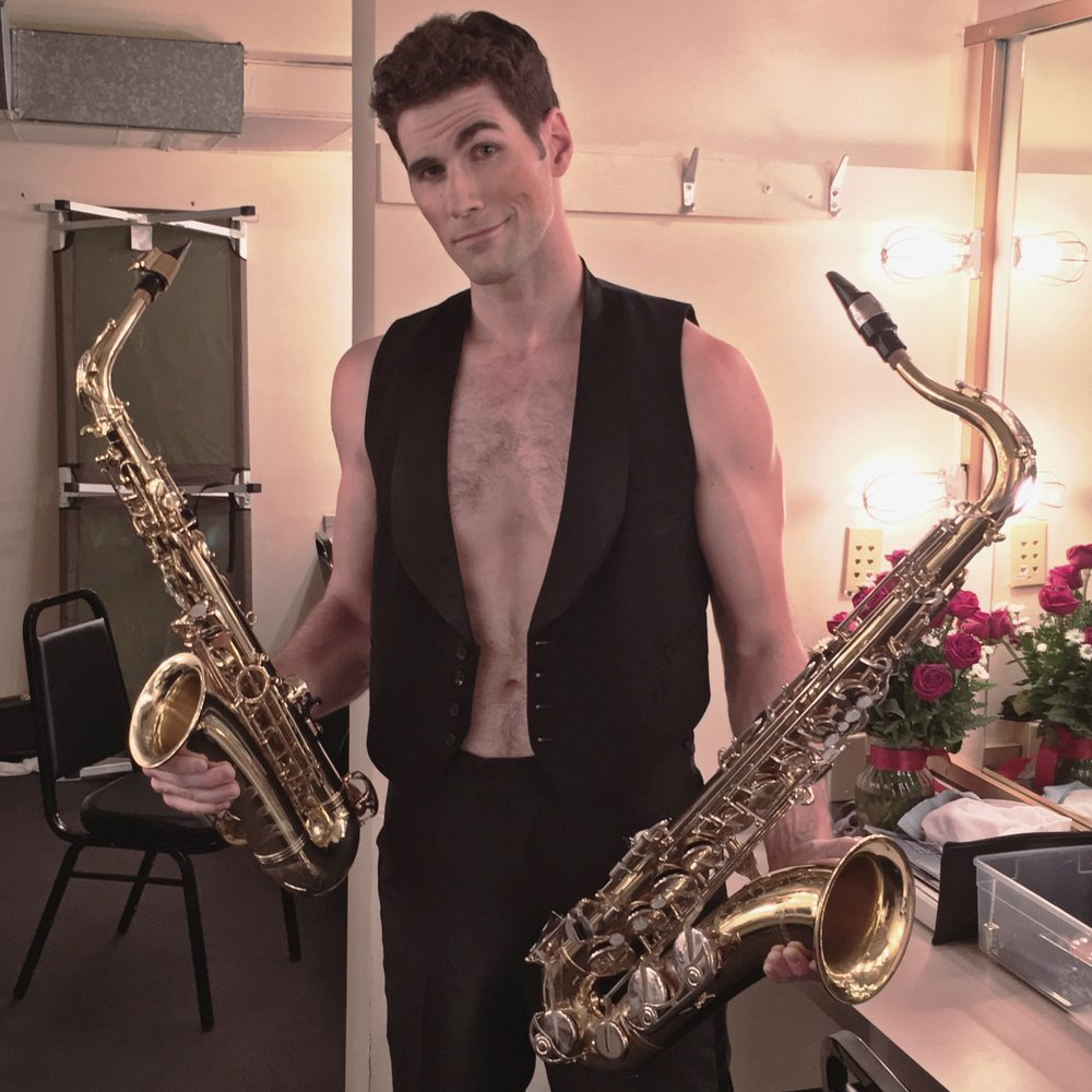 Hans, a saxophone-playing man of the Kit Kat Klub
