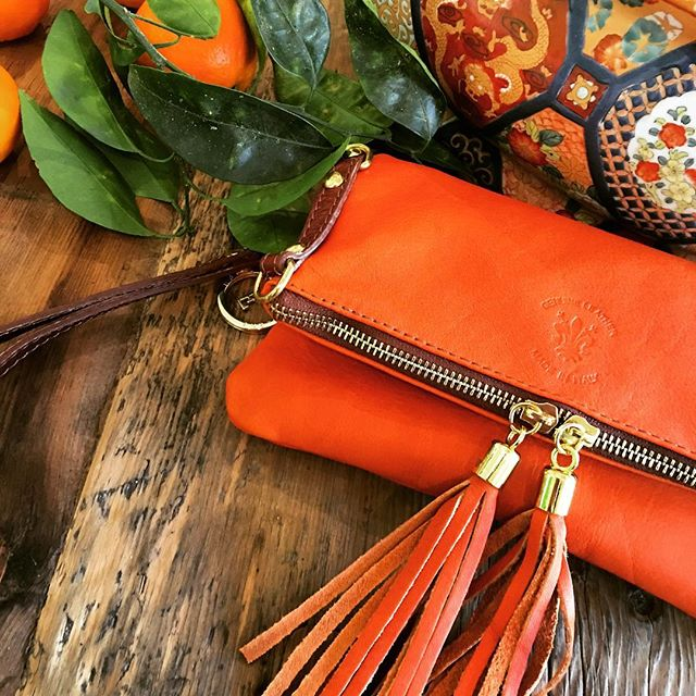 TUSCAN ORANGE.  #handbags #tuscanorange #orange #clutch #leatherclutches #handcrafted #leatherbags #southernhighlands #leatherclutch