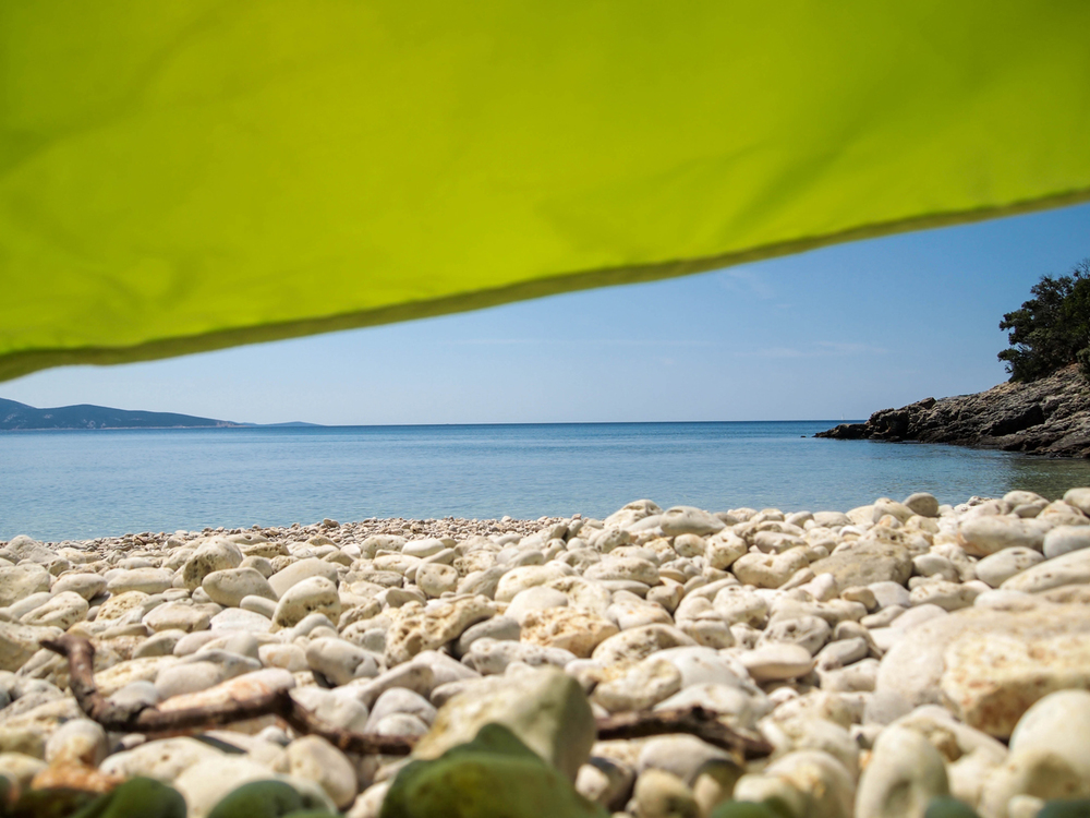 Hiding from the sun on Martinscica beach