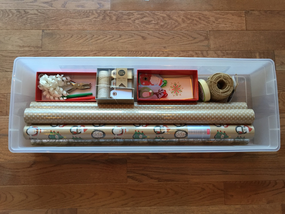 Here are all my gift wrapping goodies, organized and ready in a clear storage tote!