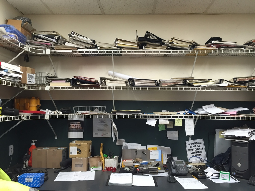 This was the office area. I knew that once we sorted, we would find many obsolete and duplicate manuals.