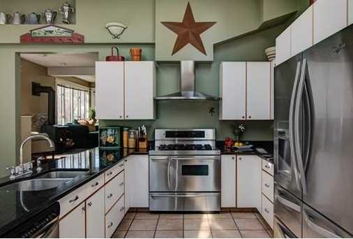 The kitchen of a home staged by  D Organizing .