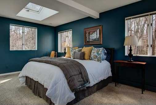 The bedroom of a home staged by   D Organizing  .