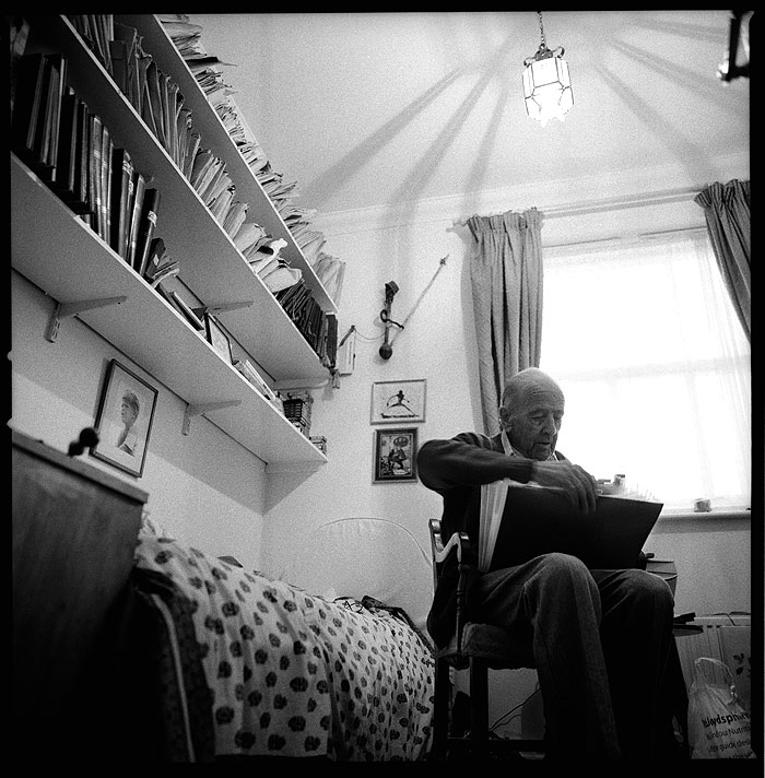 Terry looking through a folder of negatives from his archive. STUNICTSPEN002