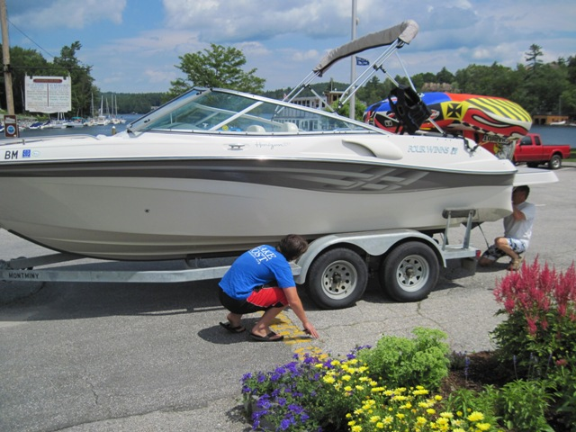 Lake Host performing a courtesy boat inspection