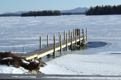 This is an example of a  better  practice with a de-icer because there is only a small patch of open water around the dock.