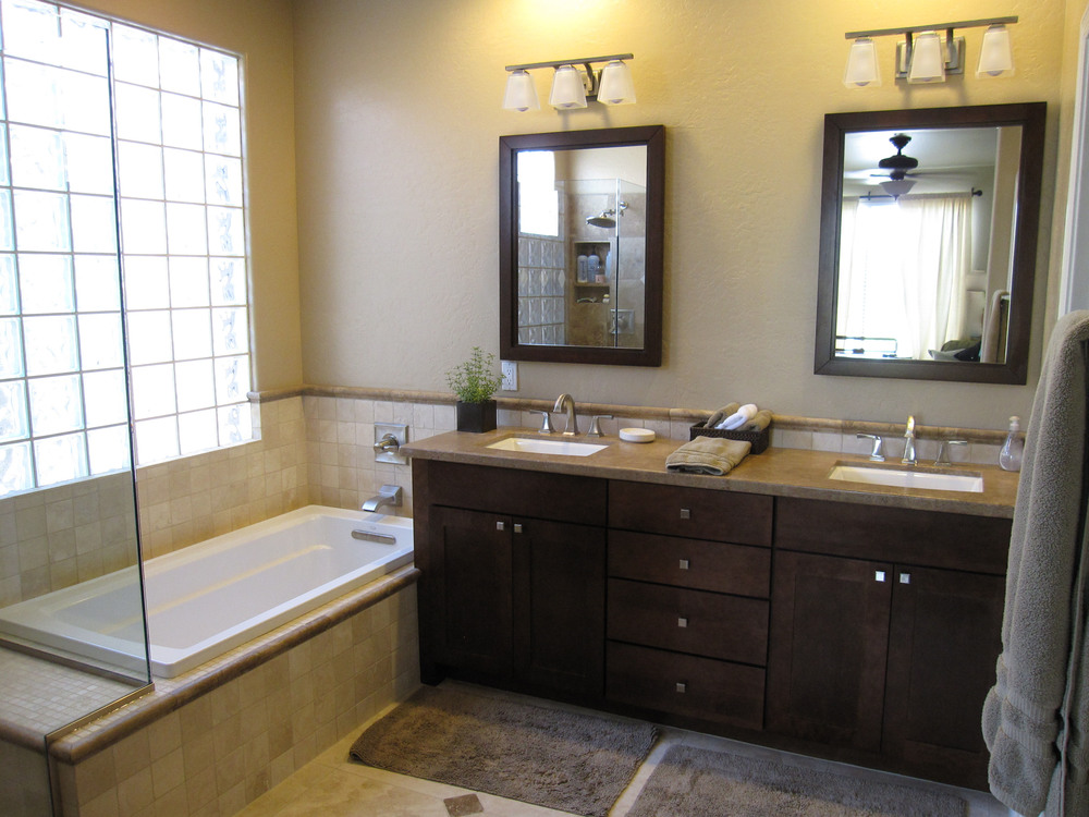 fabulous-dark-brown-wooden-cabinet-plus-double-sink-and-mirror-beside-cool-bathtub-and-window-plus-beige-tile-wall-and-classic-wall-lamp-also-grey-mat-for-lowes-bathroom-remodel-ideas.jpg