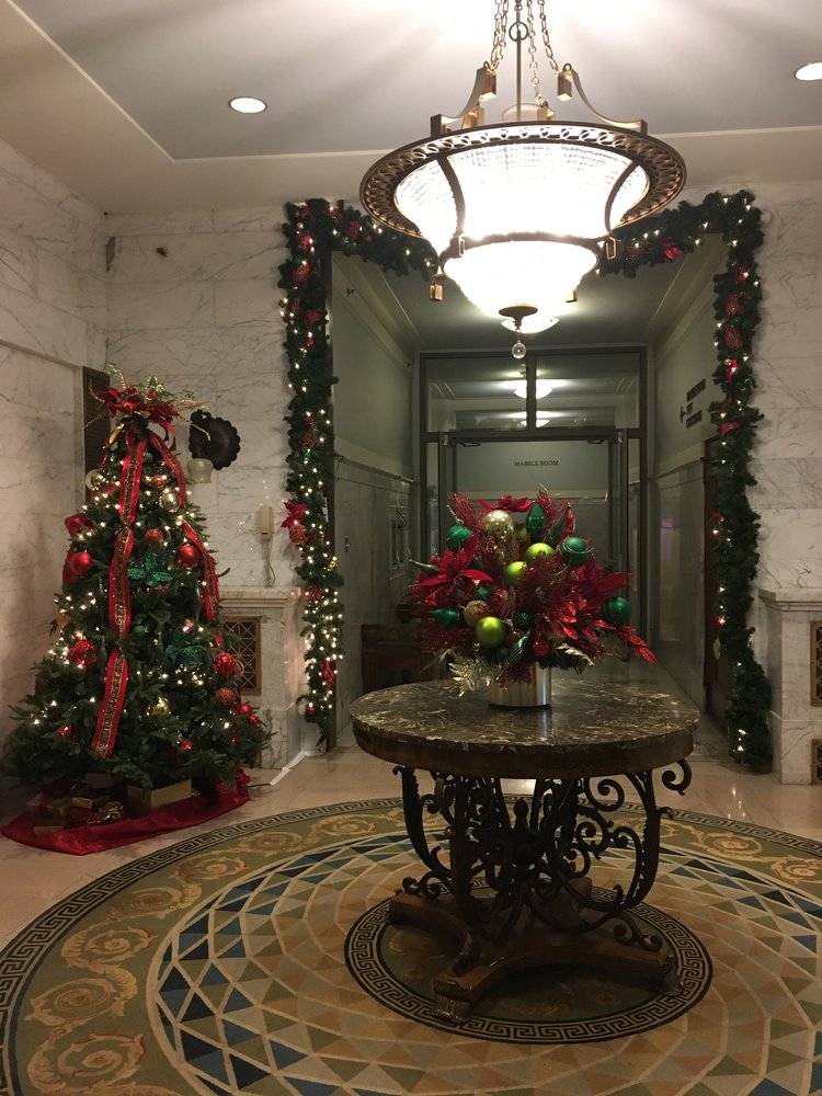 office building foyer with christmas tree and floral decorations