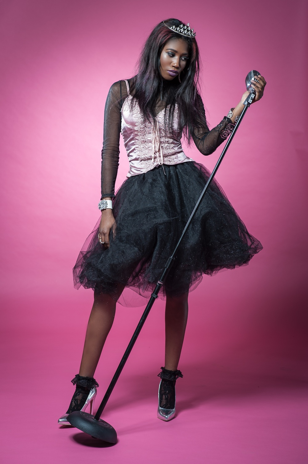 The prom queen accepts her titlein Look 1: Mesh top and pink satin bejeweled bustier, black glittery tutu (designed by me), vintage lace socks and classic silver pumps, glam accessories and the perfect prom tiara!