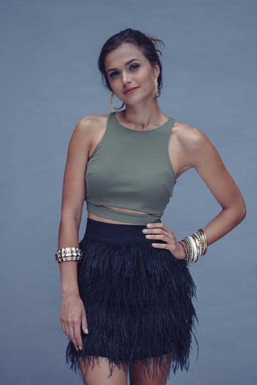 My fave look from the shoot... Polina in an olive Bebe cutout crop top paired with an Ella Moss ostrich feather skirt from Babe and a mix of golden bangles and hoops.