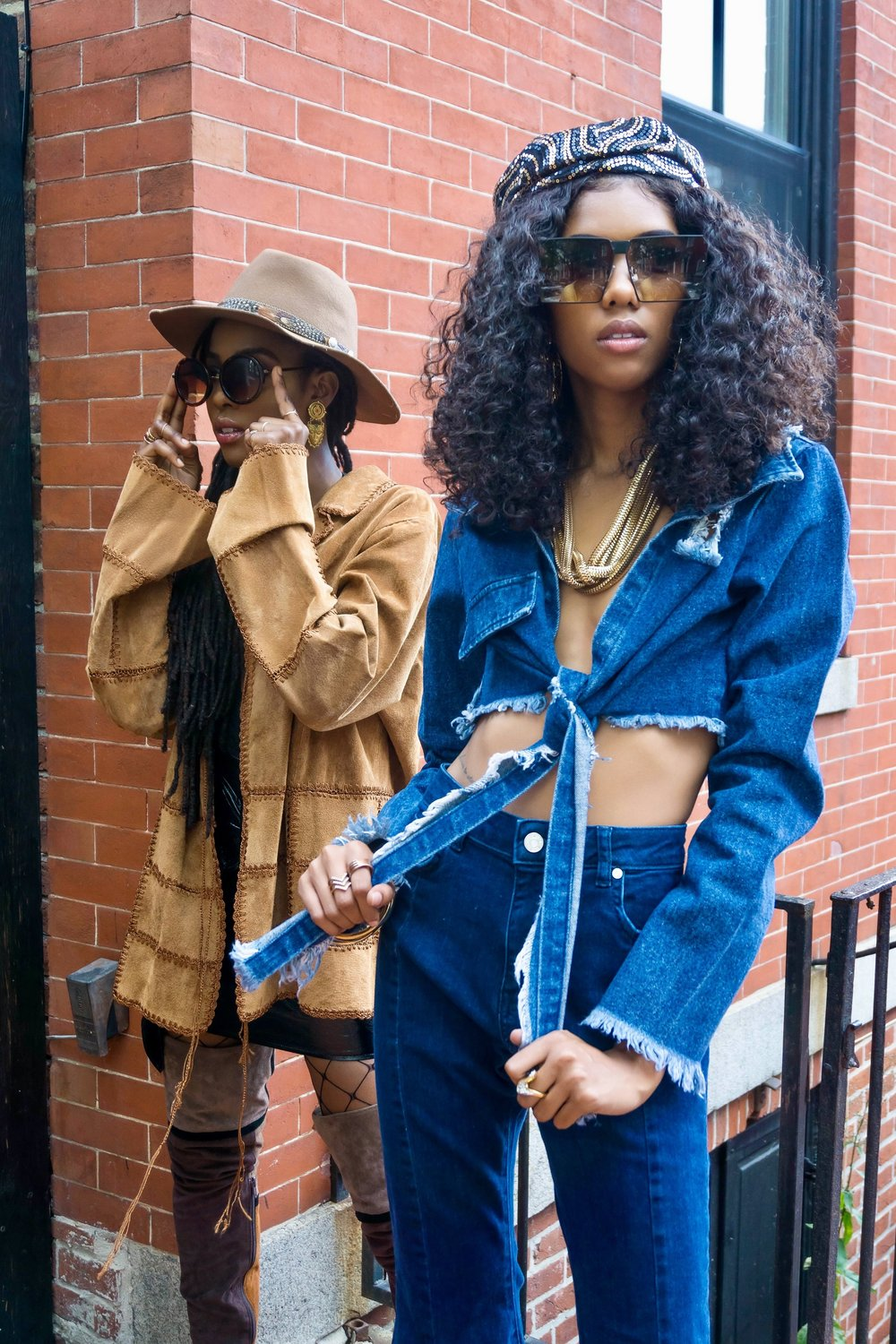 What's The Move?      Tenea is wearing a  vintage Suede in Texas patchwork oversized jacket ,  lace plunging neckline bodysuit ,  Missguided faux leather belted mini skirt ,  Jeffrey Campbell colorblock thigh high boots , vintage brim hat, jewelry, and circle frame shades. Dominique is wearing the  Off the Edge denim crop top  by Naked Wardrobe,  Missguided blue mid rise extreme flare skinny jeans ,  denim caged ankle boots , vintage sequin beret,  Missguided 99 problems earrings  and  Pretty Little Thing sunglasses , Forever 21 bangles, necklace from my wardrobe collection.