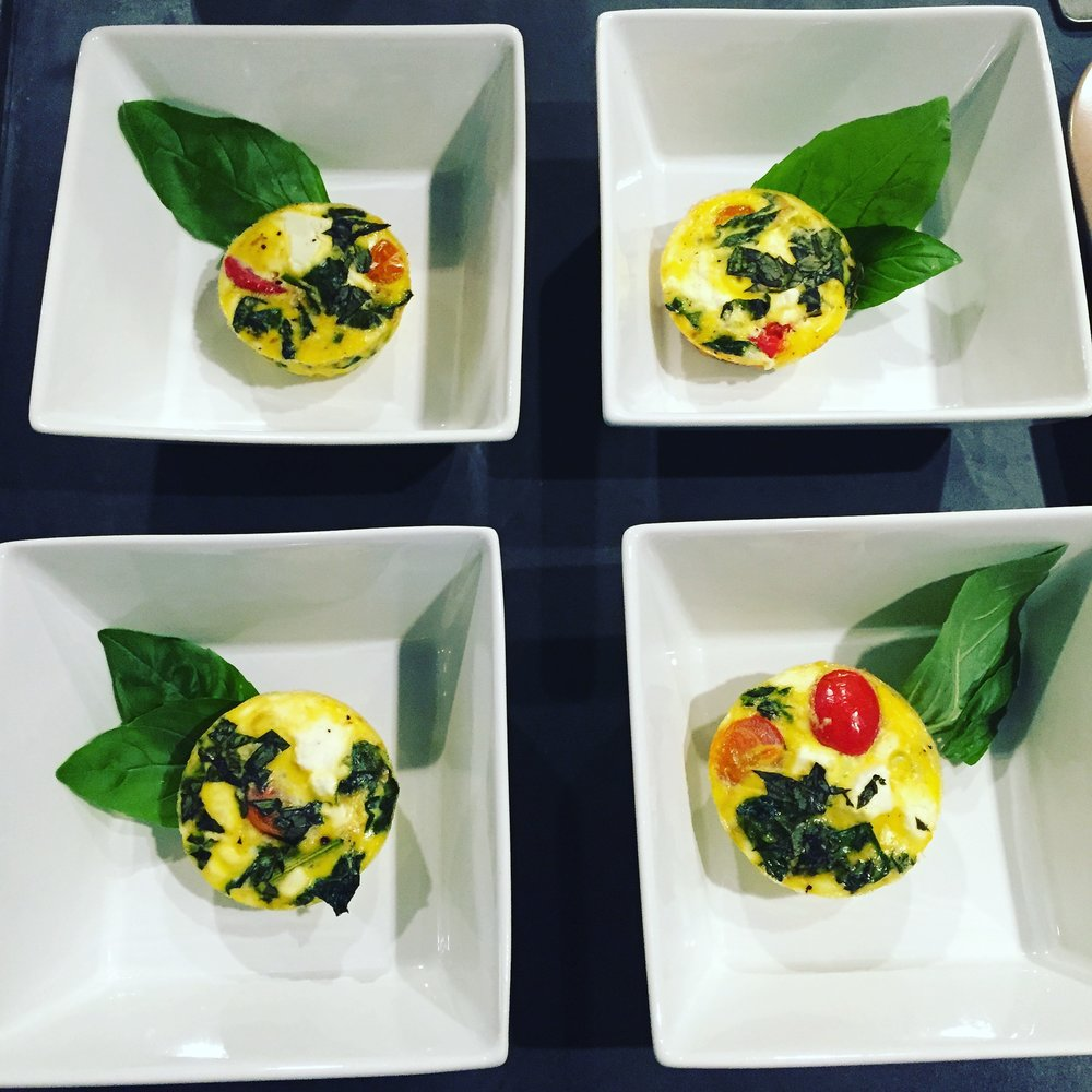Veggie Egg Cups, garnished with fresh basil, as plated for the Om to Yum event at the Easton Public Market.