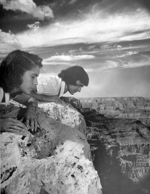 Tourists peer over the Grand Canyon's rim in 1947