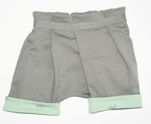 http://www.omamimini.com/shop/om43-grey-with-animal-pattern-print-baby-shorts-with-asymmetrical-pleats-and-print-on-cuffs