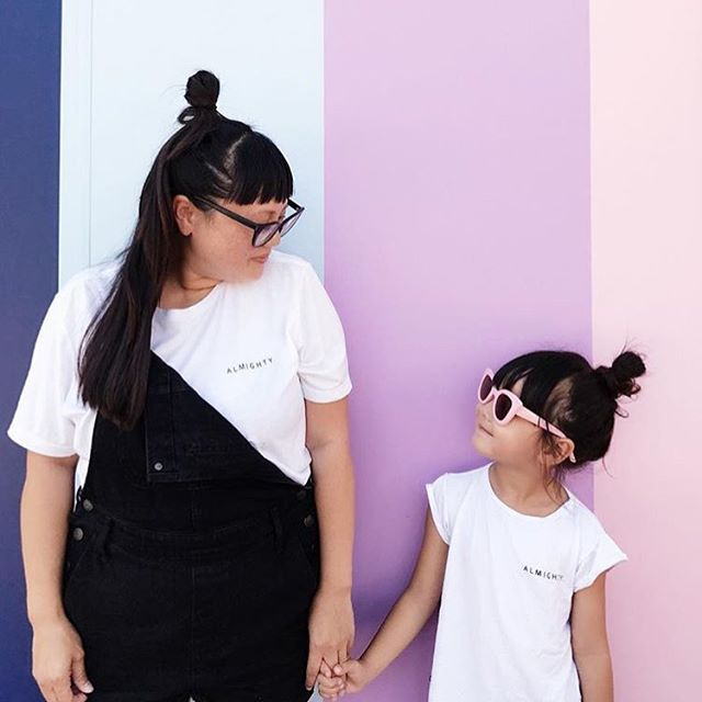 Ma gurls! @zooeyinthecity & @maisassygirl showing #twinning done right in our #almighty tees 🖤 . #pwrgrl #omamimini #aom #capsulecollection #madeinla #superwoman #supergirl #mommyandme