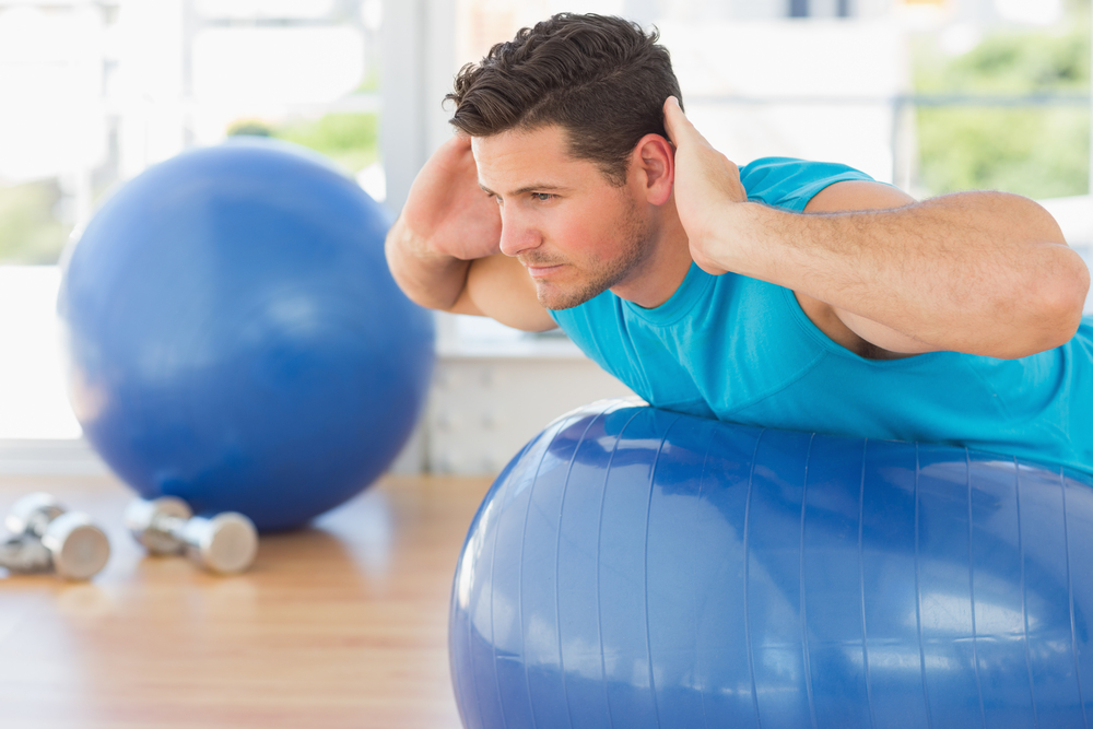 Man-exercising-on-ball.jpg