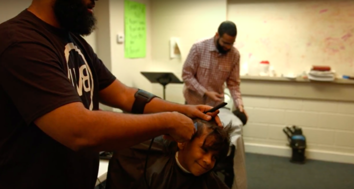 Epiphany Fellowship of Camden providing free resources, such as hair cuts, to local community members, 2016.