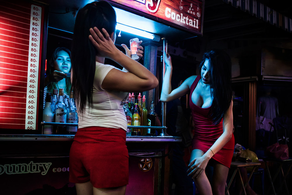 "Two ladyboy on break during a typical night long the ""Walking street"". Thailand-Pattaya"