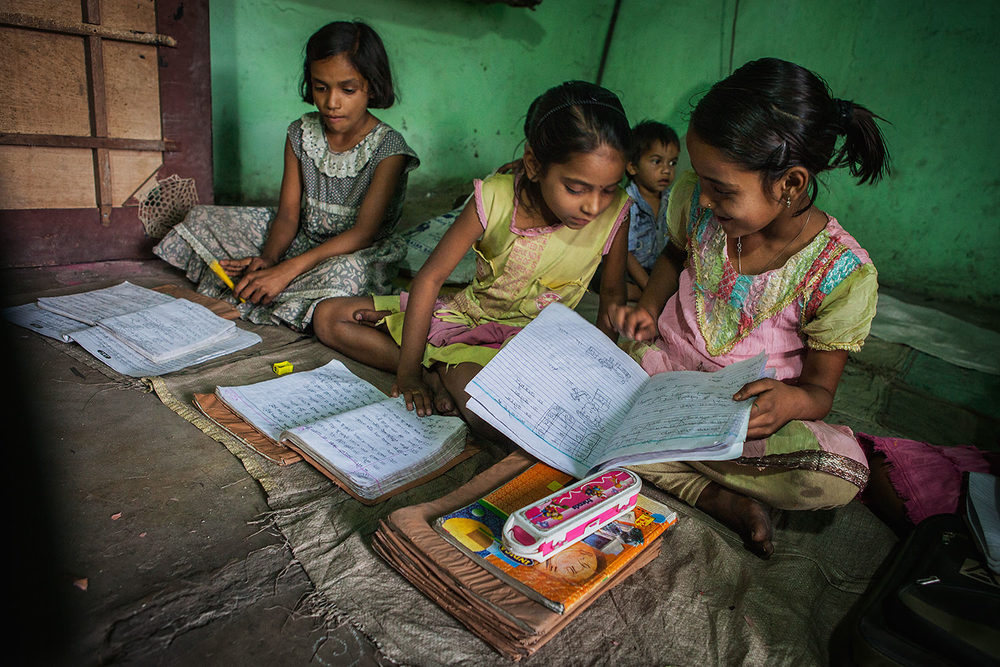 Three Indian children play homework after school. Bokaro- India