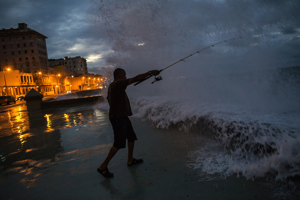 Fisherman during a storm on the Malecon . Habana - Cuba