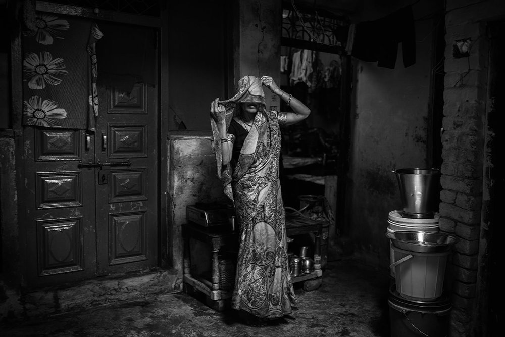 Portrait of an indian woman inside her house. Agra- India