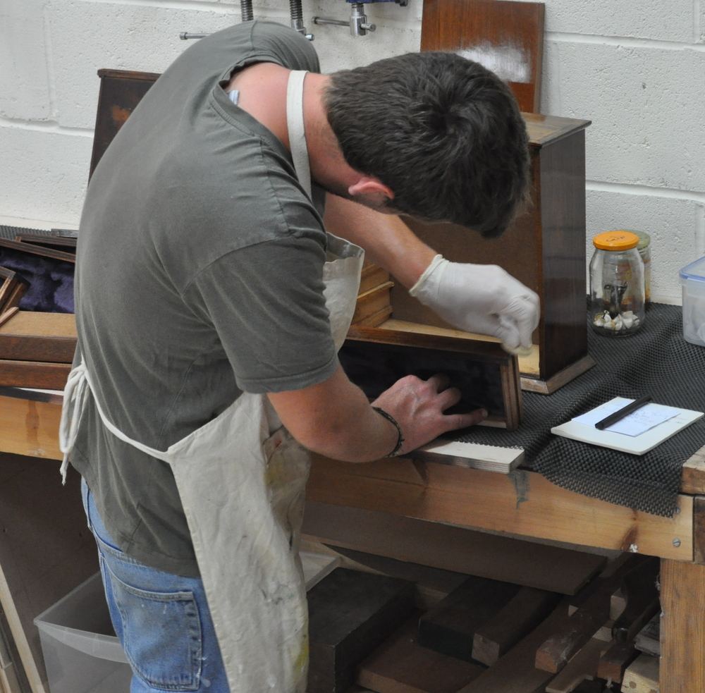 A student French Polishing a box