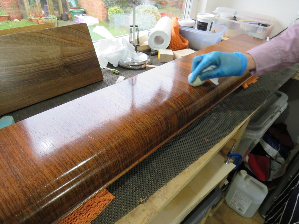 above: Robert French polishing a piano