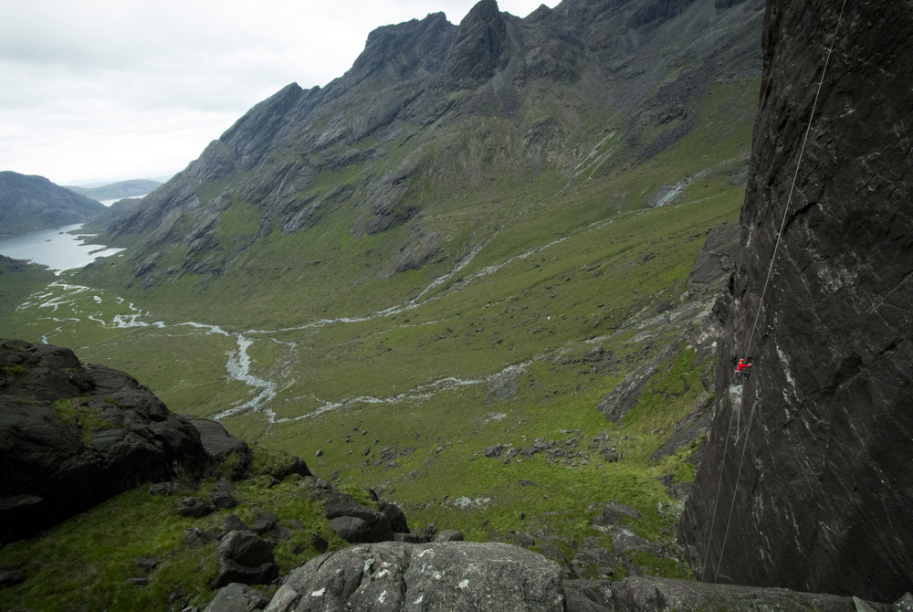 Charlie, at the top of the first pitch, on the 100m static rope that we carried in to the base of the route. Loch Coruisk in the background.