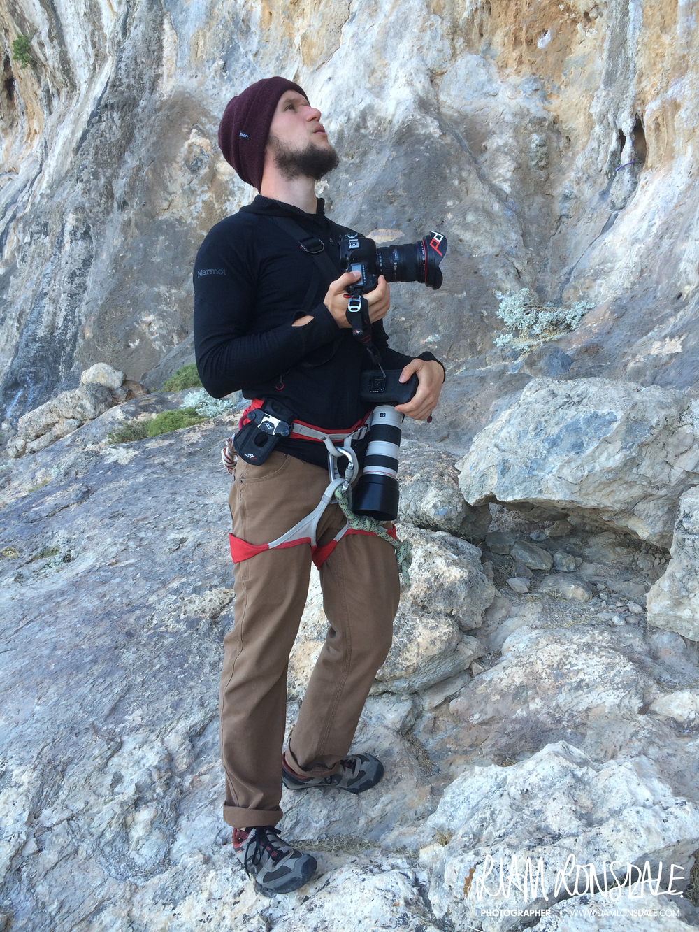 Scouting the bottom of the crag. CAPTURE PRO is visible mounted on my harness with the PRO PAD for maximum comfort. CLUTCH is on my right hand, on the 5d. SLIDE is over my shoulder, long lens on the end.
