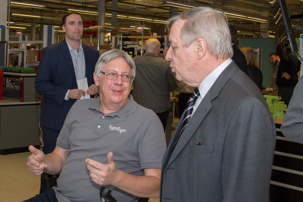 U.S. Senator Dick Durbin views a SymGym demo.