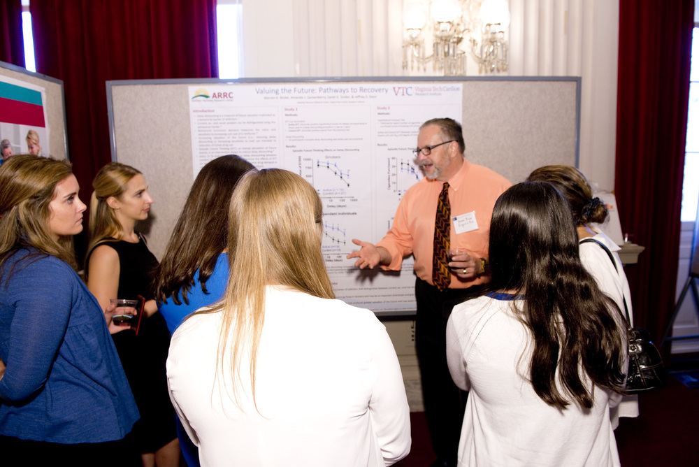 Psychologist Warren Bickel of the Carilion Research Institute at Virginia Tech explains his research on improving drug treatment to congressional staff at the OBSSR 20th anniversary poster session on Capitol Hill. (Credit: Charles Votaw)