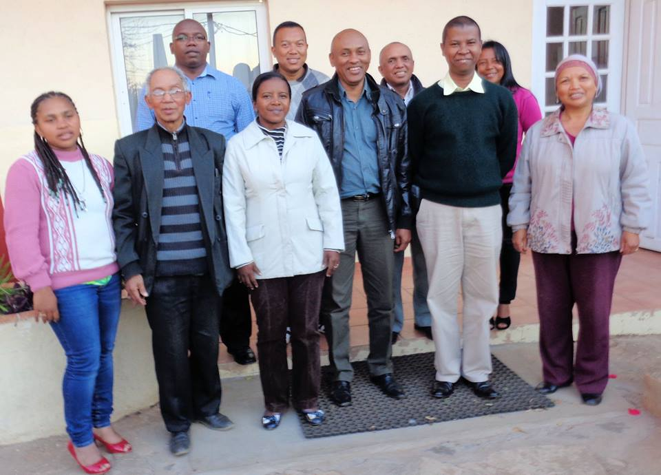 Newly elected board members of MIR Madagascar pose after the board meeting in Antananarivo