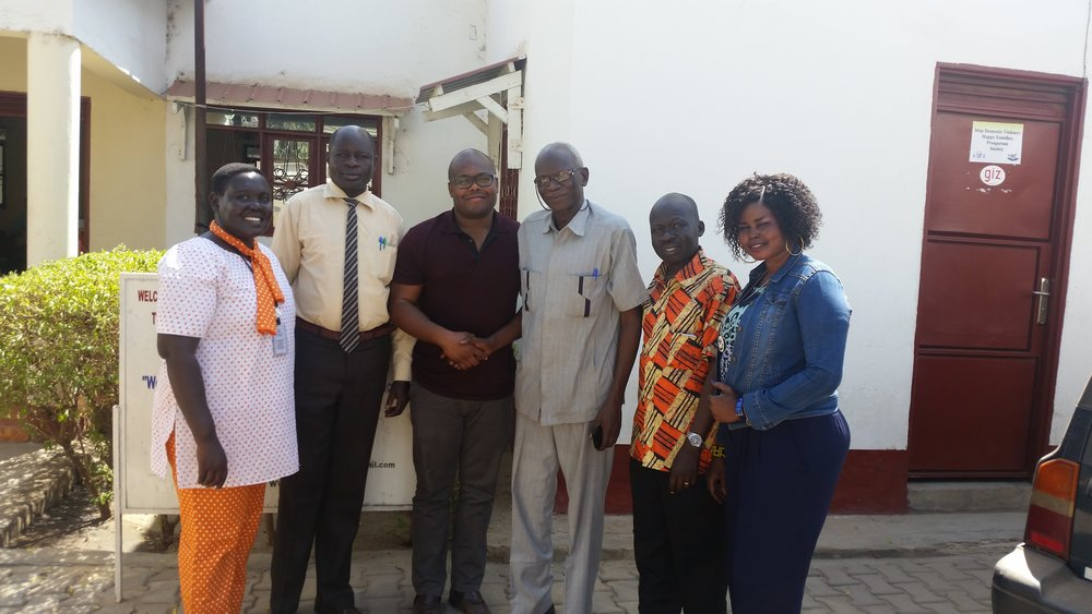 In front of ONAD's offices after a meeting with Dr. George Louis Tokporo ONAD's Chair and Moses Telar Cindut the Director of the Bureau of Religious Affairs. (Left to Right: Flora Francis, Moses Telar Cindut, Lucas Johnson, George Tokporo, Moses Monday John, ONAD Executive Director, ONAD Volunteer.