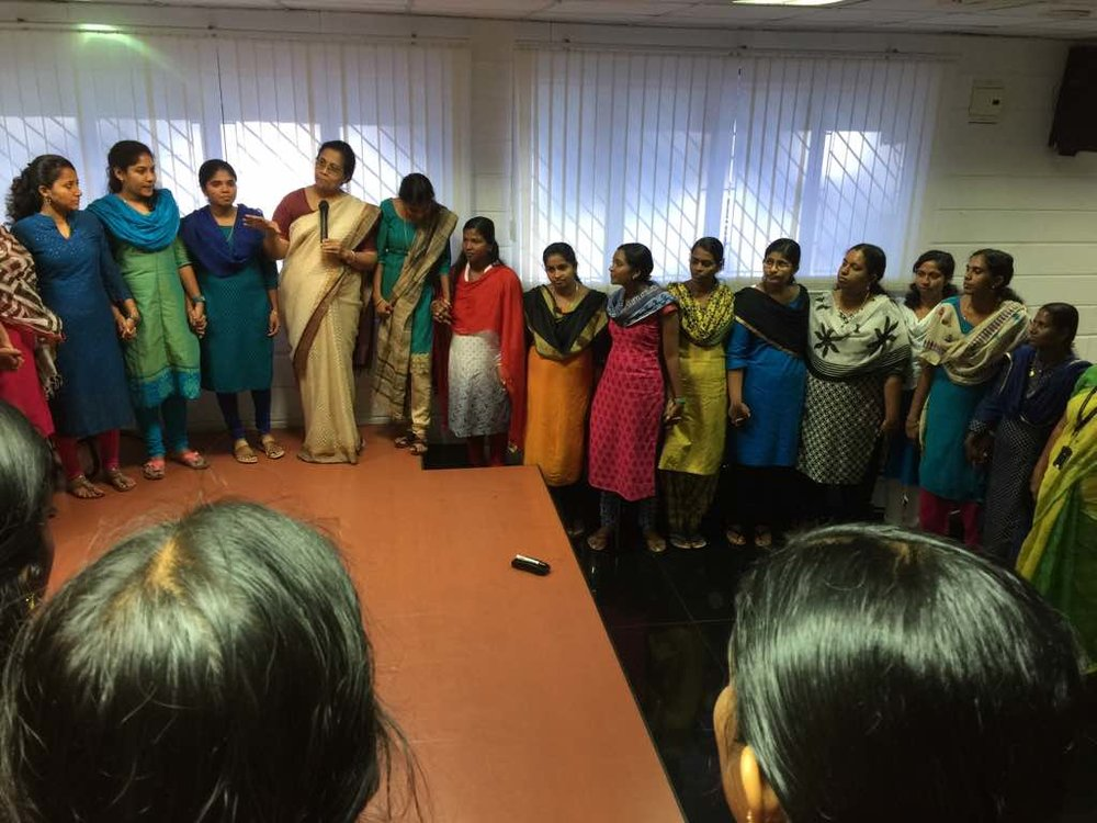 Dr. Suseela Mathew speaking to a group of young women.
