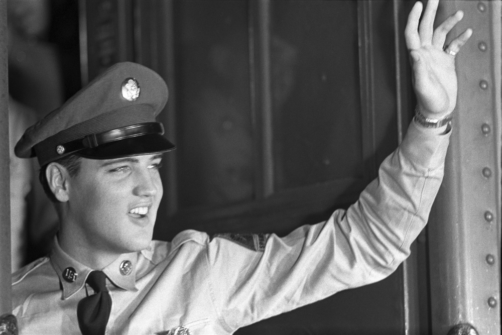 Elvis waves goodbye to his fans as he leaves on his deployment to Germany from the Brooklyn Port of Embarkation, New York. September 22, 1958