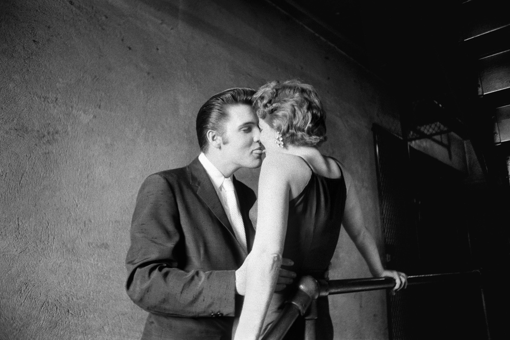 """The Kiss"" at the Mosque Theater.  This is perhaps Al Wertheimer's most iconic photograph of Elvis."