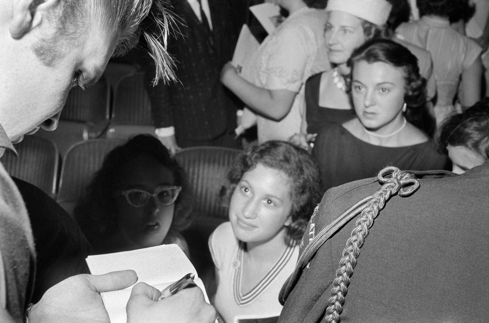 Elvis signs autographs for his fans inside <i>The Jackie Gleason Show</i>Studios. January of 1956