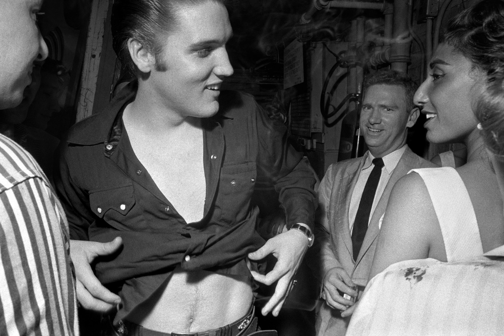 While changing out of his clothes after <i>The Steve Allen Show</i>, Elvis is easily distracted by a beautiful girl.