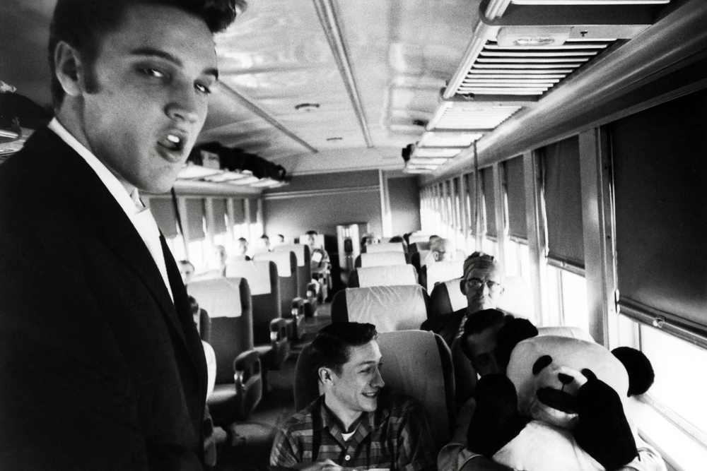 A three-foot-tall stuffed panda mysteriously arrives in Elvis's seat on the first day of the train ride, and rumor has it the Colonel is responsible.