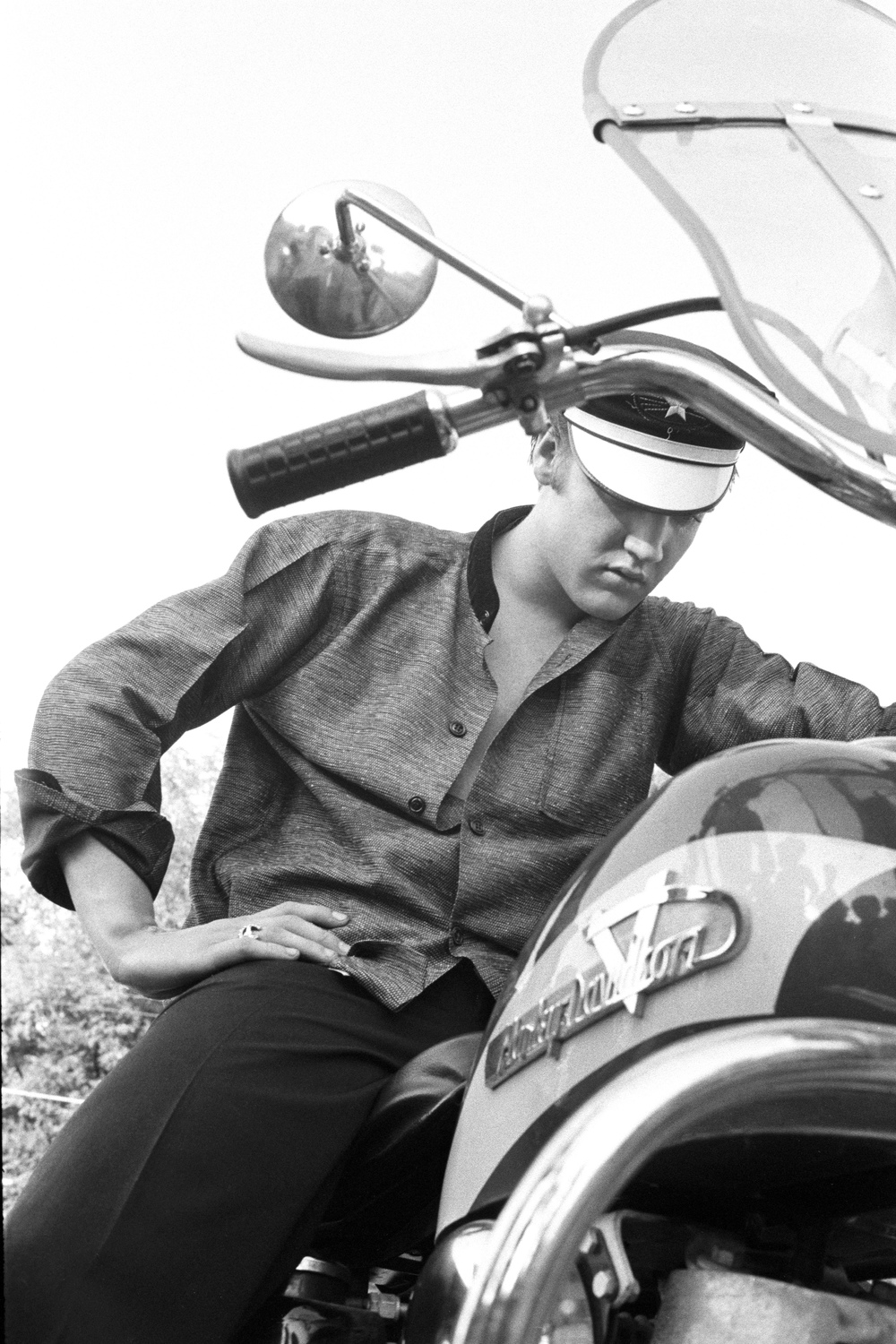 Elvis on his Harley-Davidson, wondering why it won't start, Memphis, Tennessee. July 4, 1956