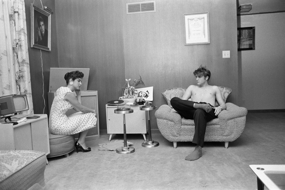 Barbara Hearn comes by Elvis's house before a concert, to listen to an acetate disc from an RCA Victor recording session done a few days earlier.