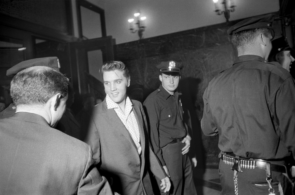 Sometimes Elvis is escorted by local Police when crowds of fans are waiting for him.