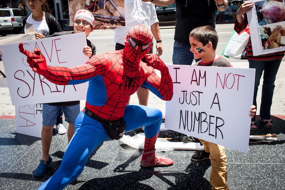 Spiderman stands in solidarity against the Assad Regime.