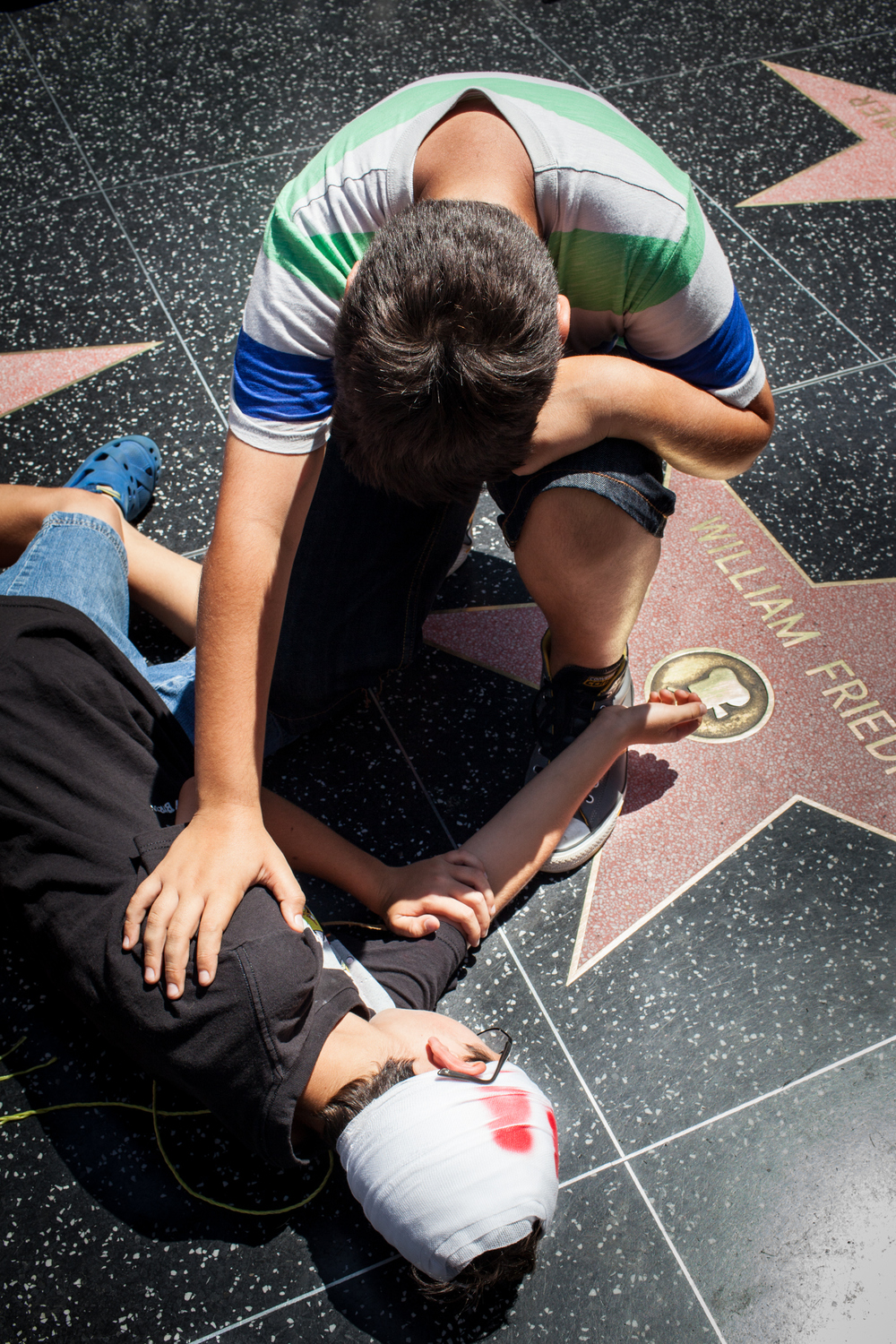 A moment of grief reenacted on the famous walk of fame.